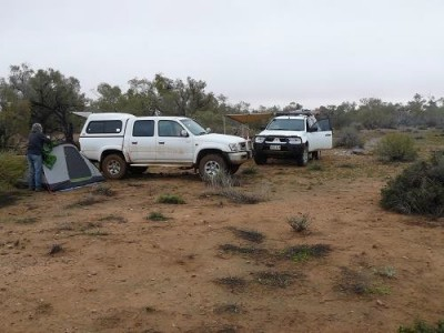 Breaking camp after a damp night on Bulldog Creek