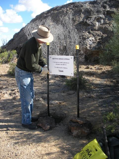 Colin Harris installing sign at Cutting Grass Spring