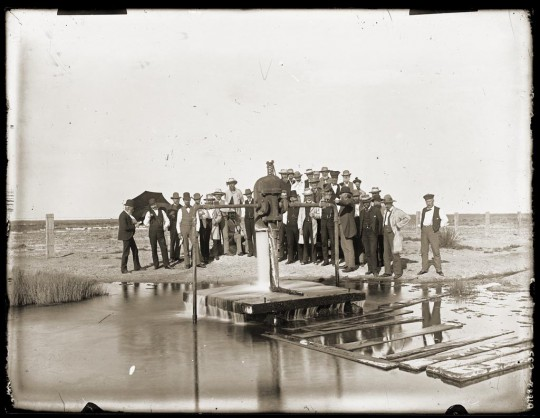 The opening of artesian bore at Coward Springs circa 1890, sunk in 1886. Henry Krischock, photographer.jpg